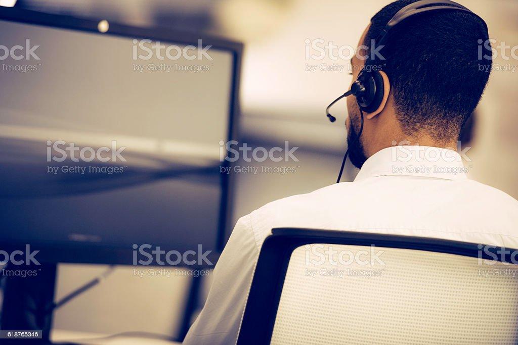 Call centre employee using a computer stock photo