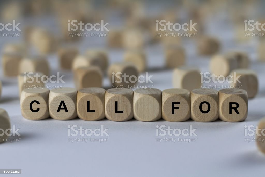 call for - cube with letters, sign with wooden cubes stock photo