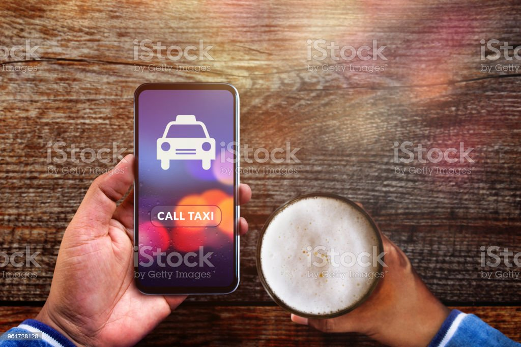 Call Taxi Application Concept. Drunker Man using Smartphone to Calling Cab in Pub or Restaurant royalty-free stock photo