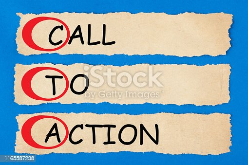 Call To Action written text on torn pieces of paper. Acronym CTA.