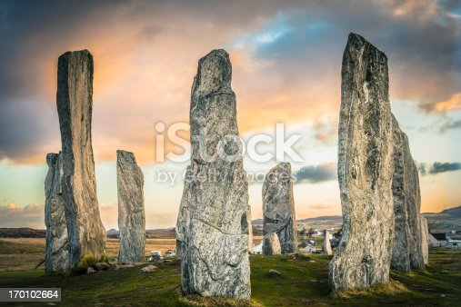 The ancient standing stones of Callanish (or Calanais) on Lewis in the Outer Hebrides of Scotland at sunrise. Built about 5000 years ago, the deeply textured stones of Callanish are arranged in allignments of avenues and a central circle not unlike a celtic cross.