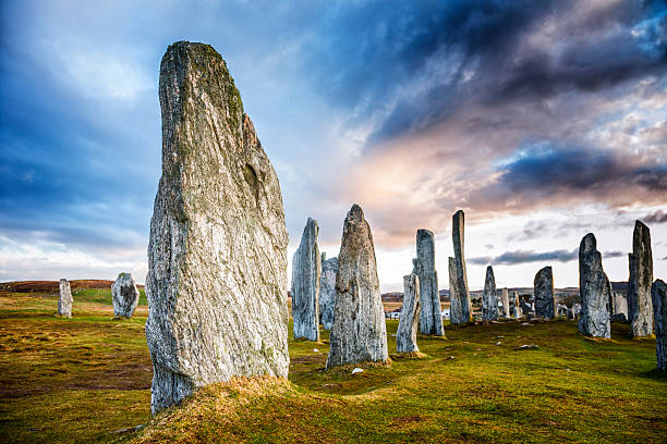 Callanish Standing Stones The ancient standing stones of Callanish (or Calanais) on Lewis in the Outer Hebrides of Scotland. Built about 5000 years ago, the deeply textured stones of Callanish are arranged in allignments of avenues and a central circle not unlike a celtic cross. theasis stock pictures, royalty-free photos & images