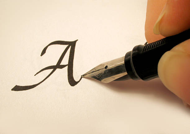 calligraphy 2 calligraphy pen and writing calligraphy stock pictures, royalty-free photos & images