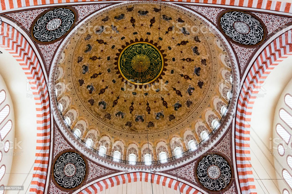 calligraphy and the ottoman art on the inside of the  dome stock photo