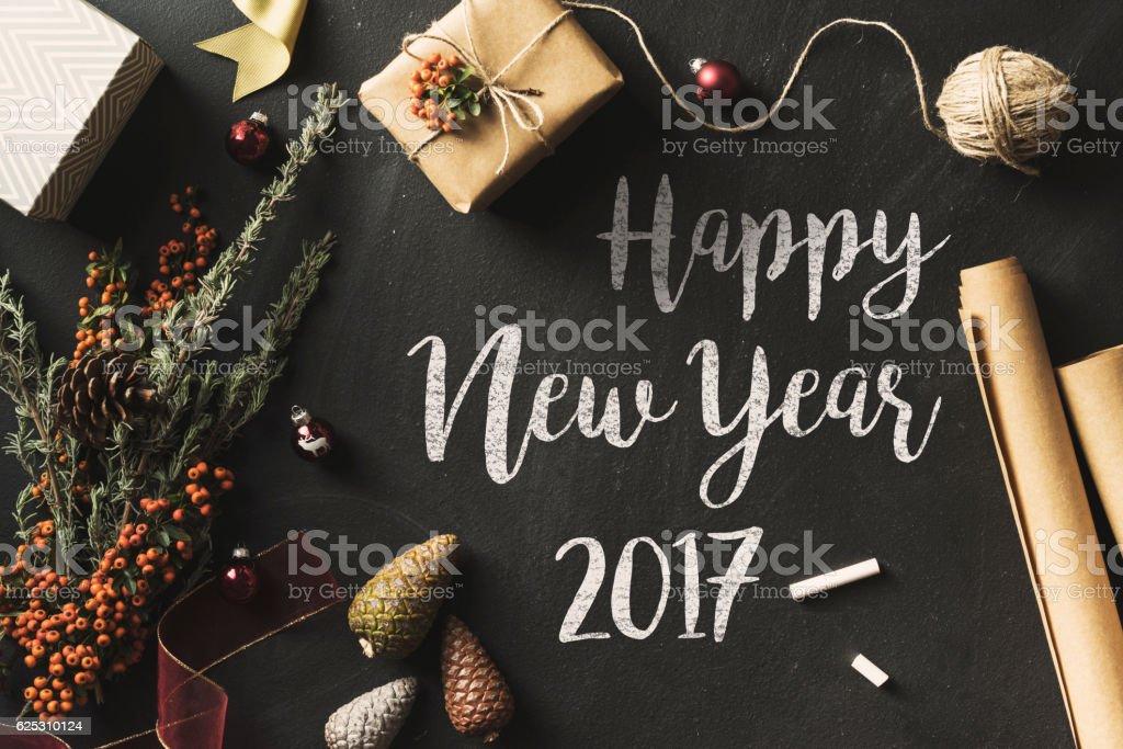 Calligraphy Happy New Year 2017 chalk written blackboard, flat lay stock photo