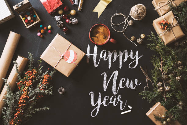 calligraphy happy new year 2017 chalk written blackboard, flat lay - new years eve stock photos and pictures