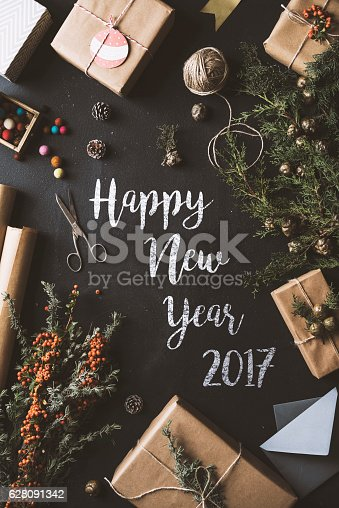 istock Calligraphy Happy New Year chalk written blackboard, flat lay 628091342
