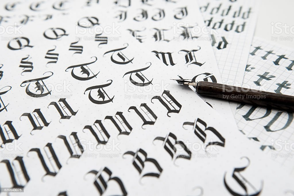 Calligraphy in Gothic style, the old font texture stock photo