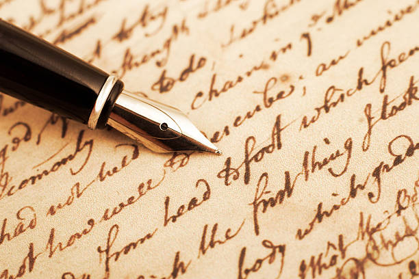 Calligraphy pen and letter closeup photo stock photo