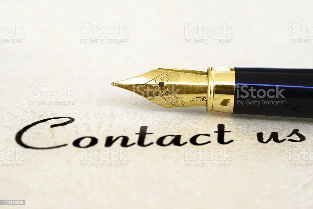Calligraphy pen on side with Contact Us written stock photo
