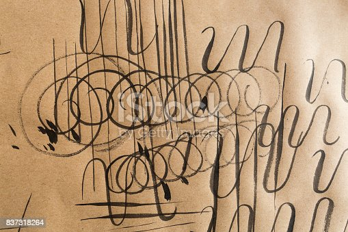 istock calligraphy, practice, education concept. on light brown paper for sketching there are lots of different types of lines such as curly, swirl, thick and thin, varied, parrellel and jagged 837318264
