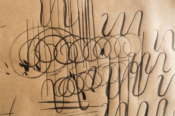 calligraphy, practice, education concept. on light brown paper for sketching there are lots of different types of lines such as curly, swirl, thick and thin, varied, parrellel and jagged stock photo