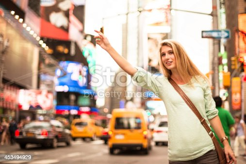 654490824 istock photo Calling a taxi on times square - NYC 453494929