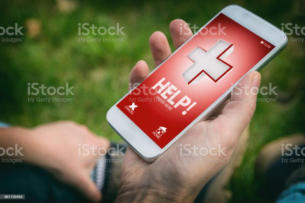 Calling for help with smart phone app stock photo