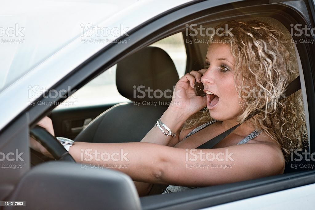 Calling mobile phone while driving car royalty-free stock photo