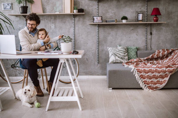 Calling mom on work Young Single Father Enjoying Free Time With Baby stay at home father stock pictures, royalty-free photos & images