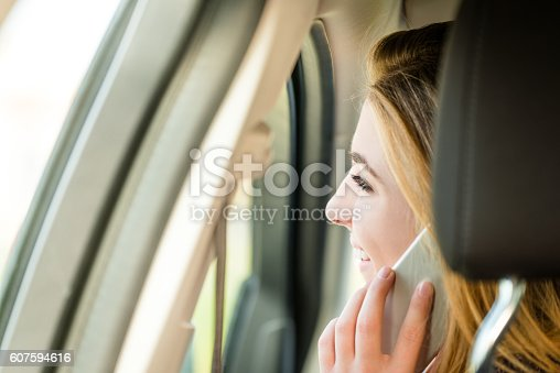 607592606 istock photo Calling phone in car 607594616