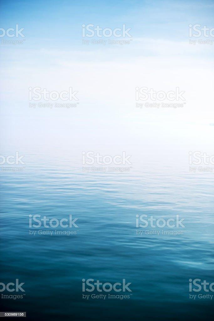Calm and deep blue lake stock photo