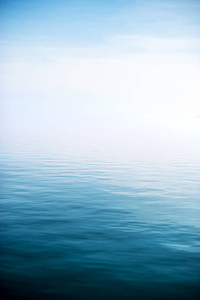 calm and deep blue lake - nature foggy calm bildbanksfoton och bilder