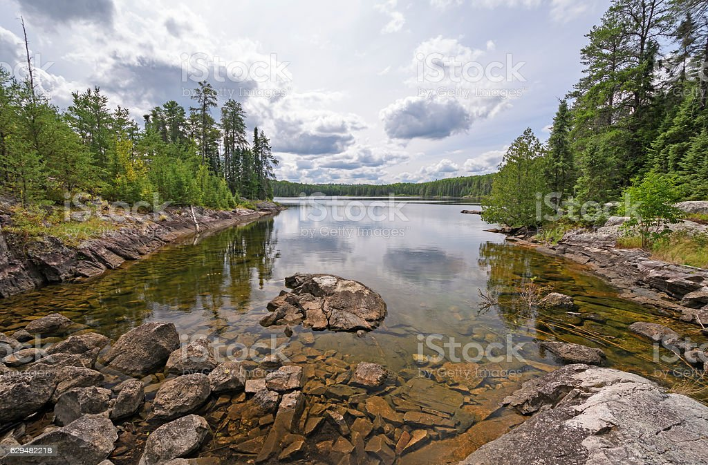 Calm Bay on a Wilderness lake stock photo