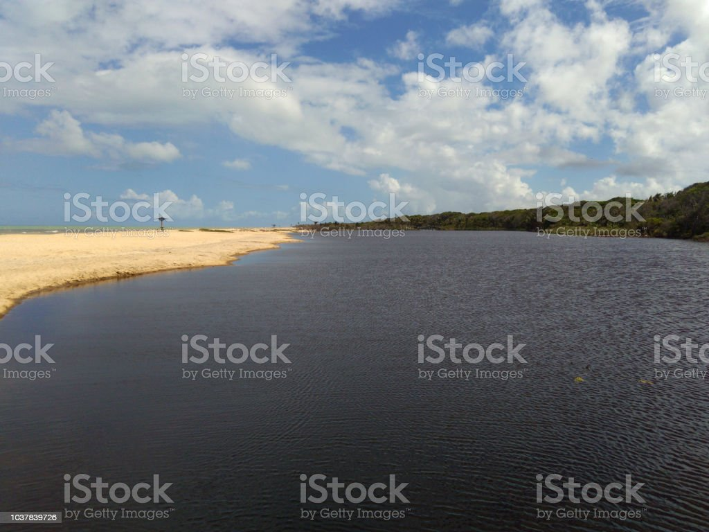Calm beach and cloudy sky in Bahia stock photo