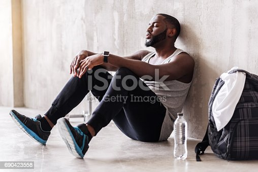 istock Calm bearded sportsman having rest time after training 690423558
