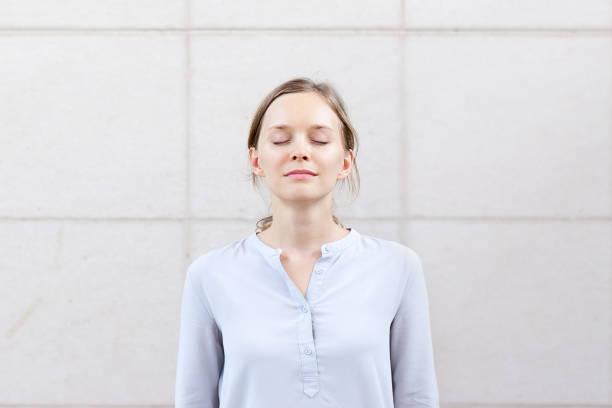 Calm beautiful businesswoman finding inspiration stock photo