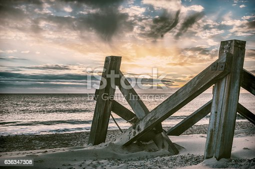 Calm before the storm. High definition image of a seaside jetty or pier. Dramatic scene on a secluded beach. Eerily calm in comparison to he storm that followed.