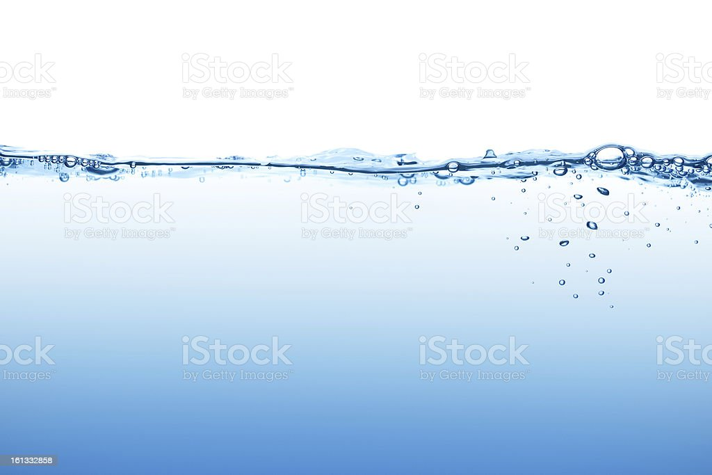 Calm blue water surface with bubbles seen at low angle stock photo