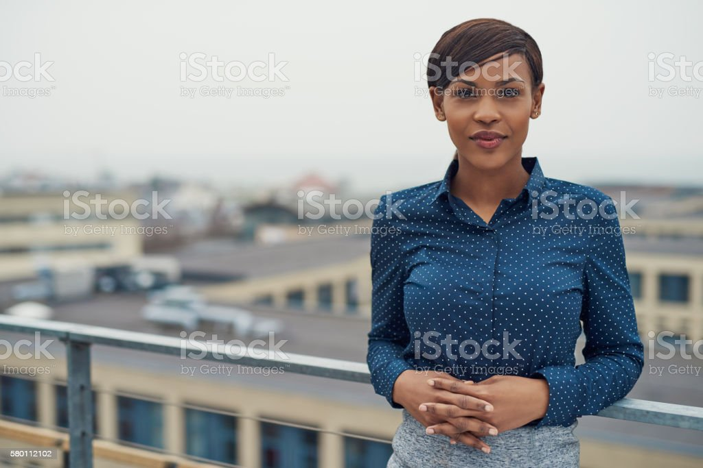 Calm business woman with folded hands outside stock photo