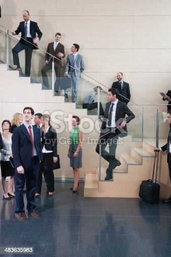 483635979 istock photo Calm businessman in busy office staircase 483635983