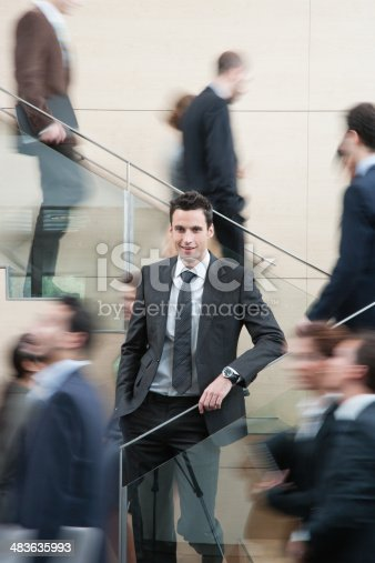 483635979 istock photo Calm businessman in busy office staircase 483635993