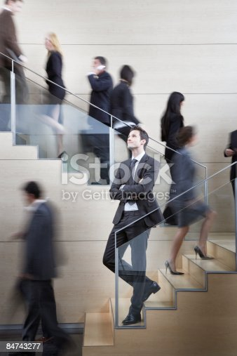 483635979 istock photo Calm businessman in busy office staircase 84743277