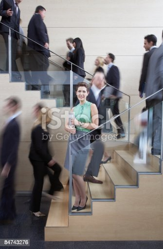 483635979 istock photo Calm businesswoman in busy office staircase 84743276