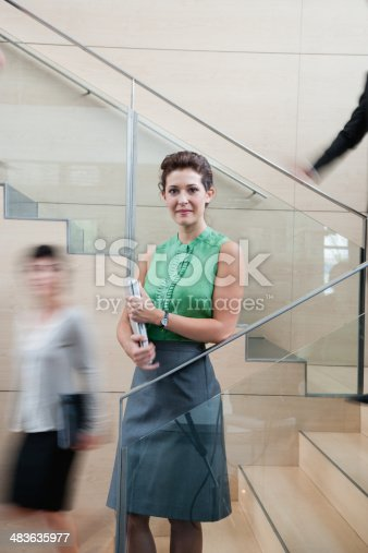 483635979 istock photo Calm businesswoman in staircase 483635977