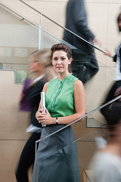 Calm businesswoman in staircase stock photo