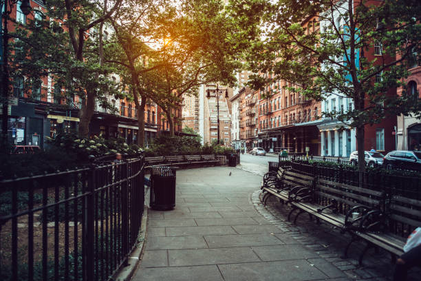 Calm city street park under sunlight in Manhattan Calm city street park under sunlight in Manhattan, New York City lower manhattan stock pictures, royalty-free photos & images
