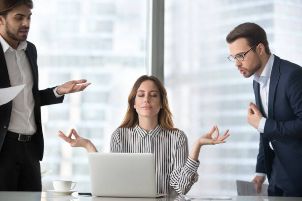 Calm female managing stress at workplace not involved in fights stock photo