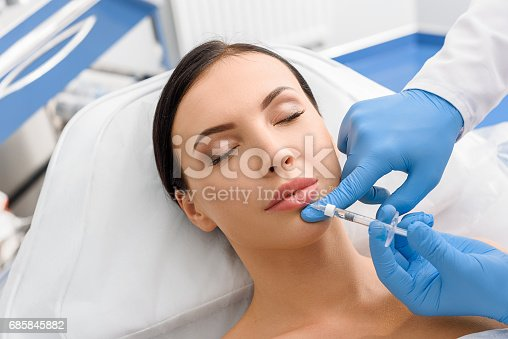 istock Calm girl getting cosmetic procedure 685845882