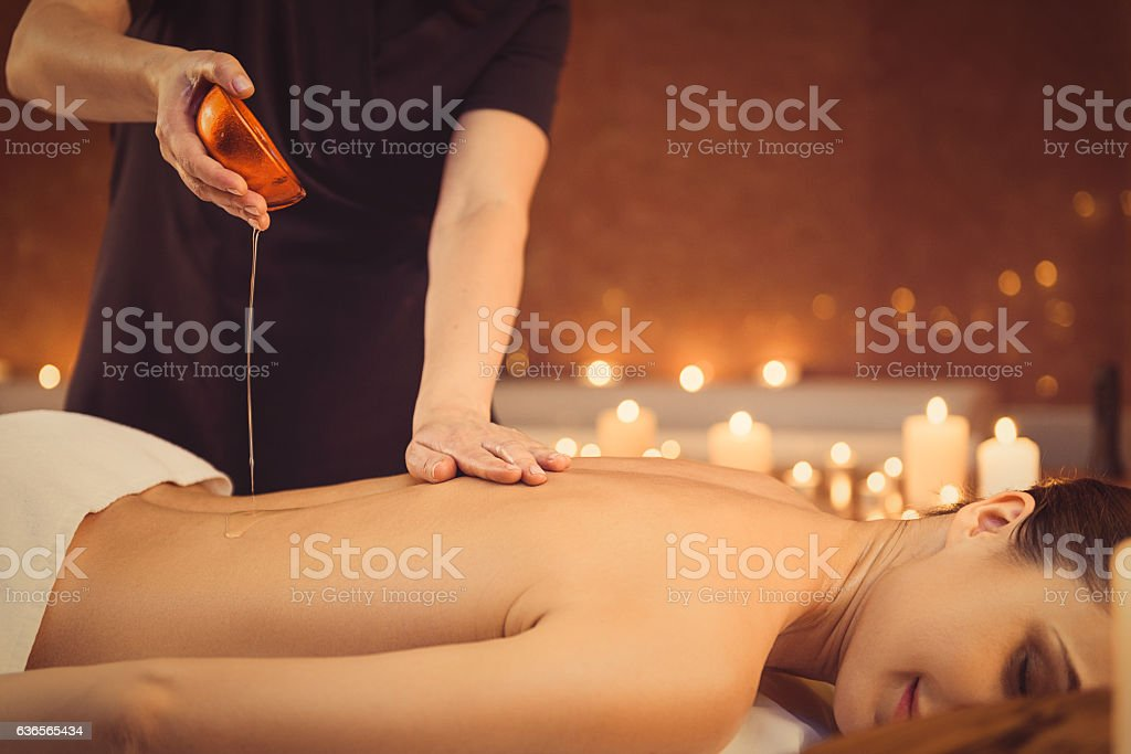 Calm girl getting treatment at wellness center stock photo