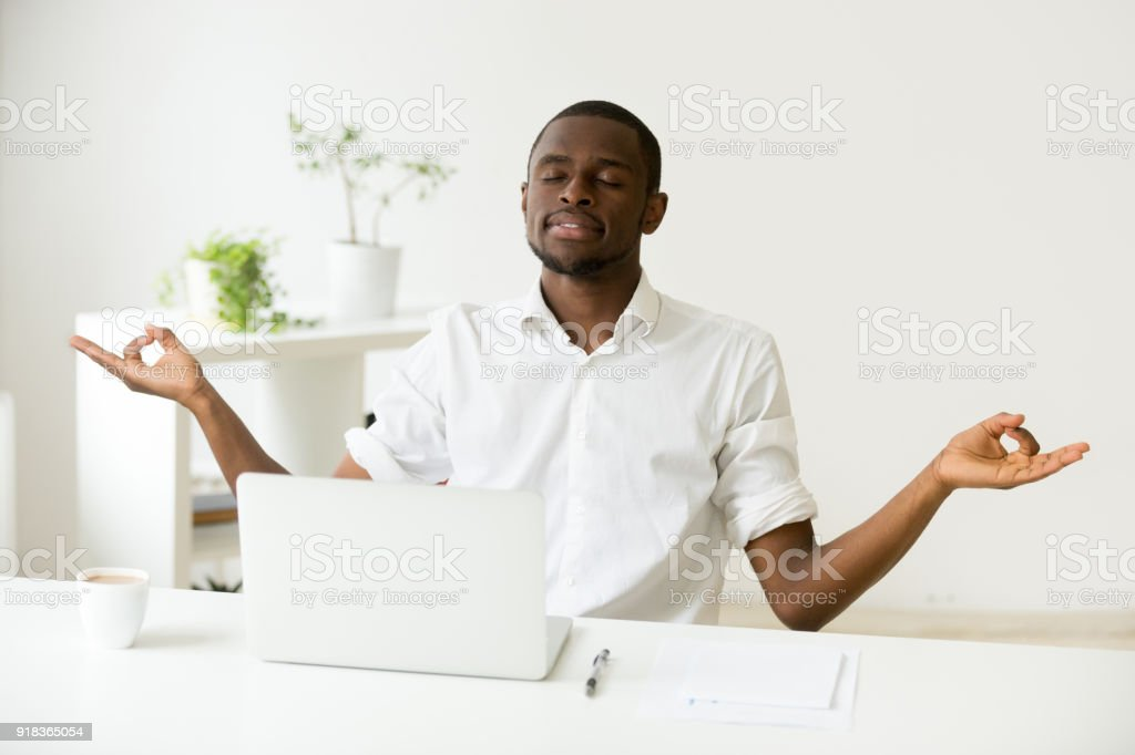 Calm Happy African Man Meditating At Office Desk With Laptop Stock Photo Download Image Now Istock