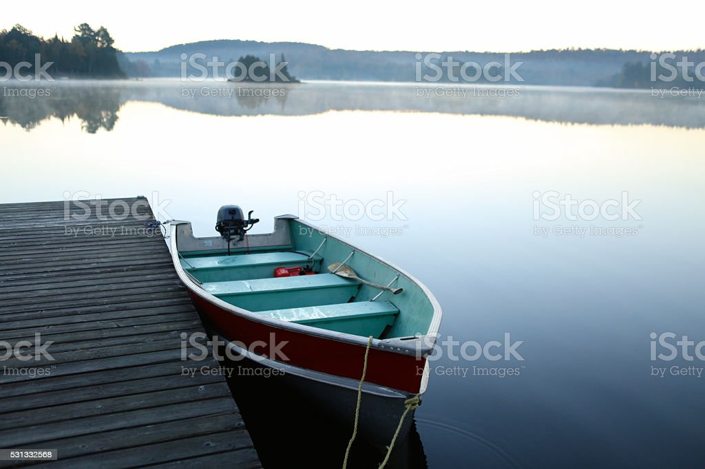 Calm Lake at sunrise stock photo