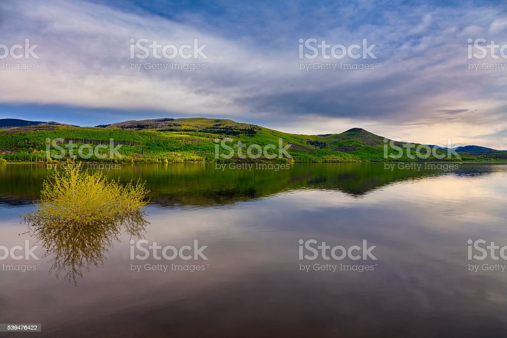 calm lake scene with near mirror reflection in the water stock photo