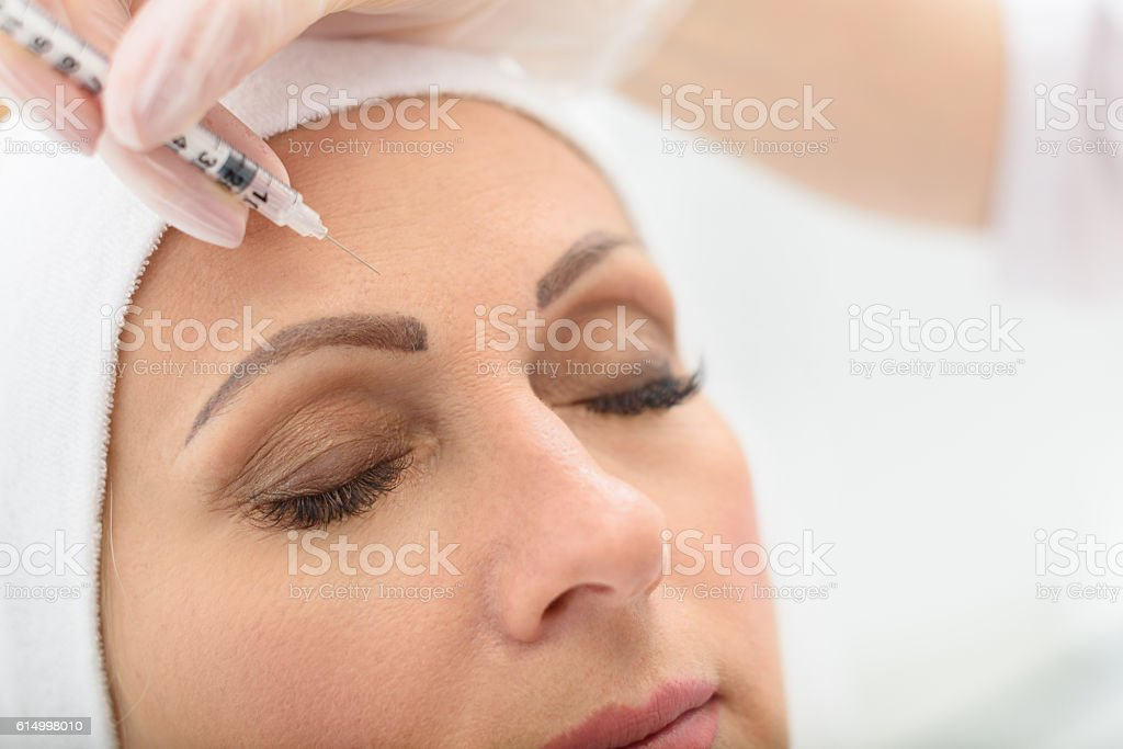 Calm mature lady fighting against wrinkles stock photo