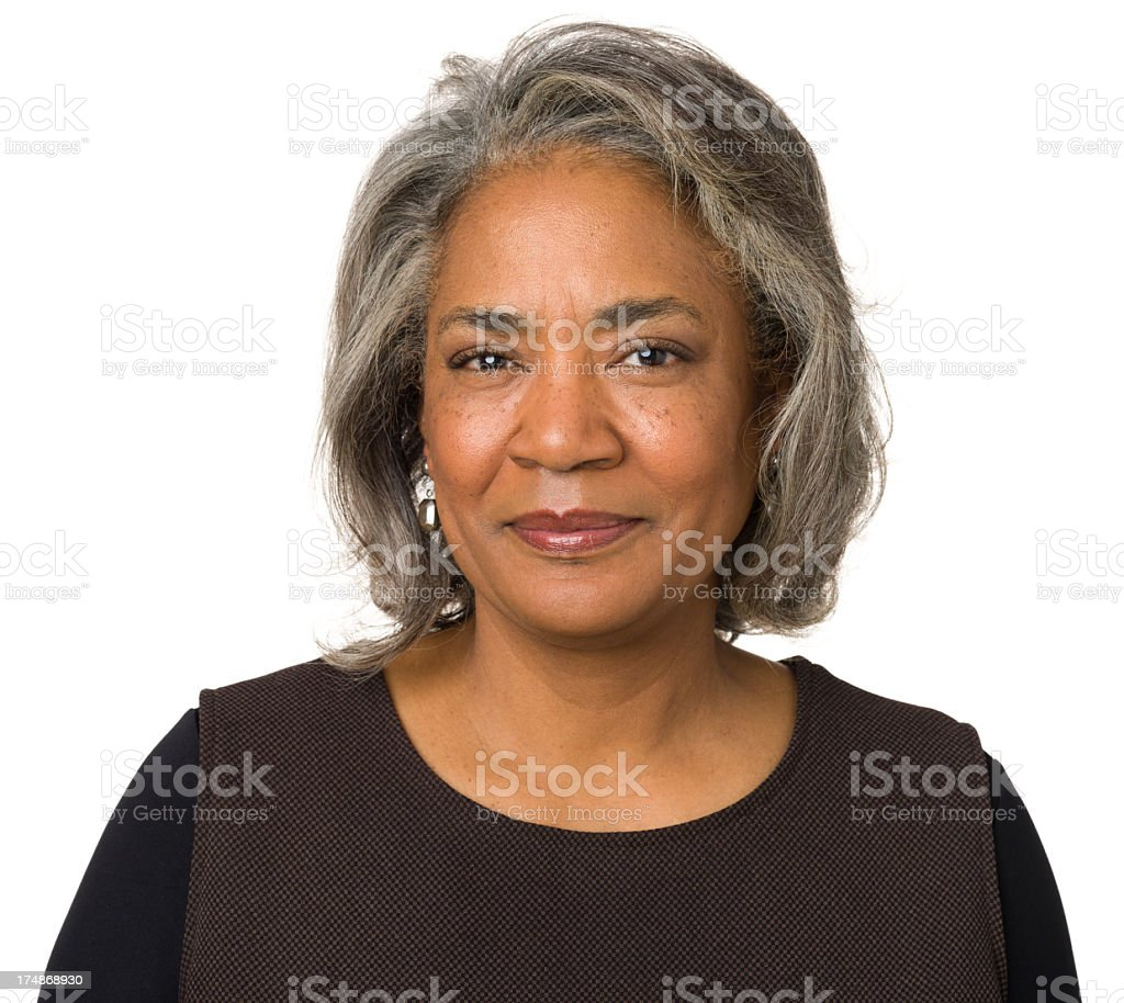 Calm Mature Woman Posing, Looking At Camera stock photo