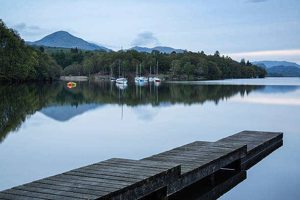 Calm moody evening landscape over Coniston Water in English Lake stock photo