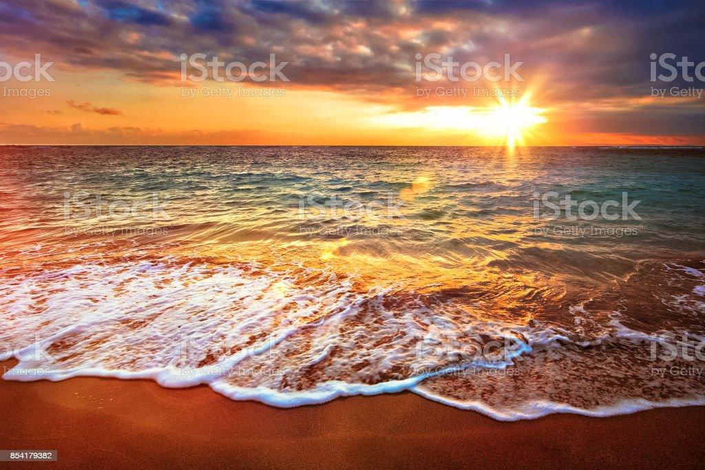 Calm ocean during tropical sunrise stock photo