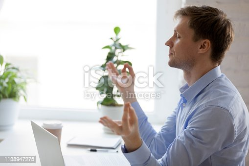 916520034istockphoto Calm peaceful businessman in meditating at office 1138947275