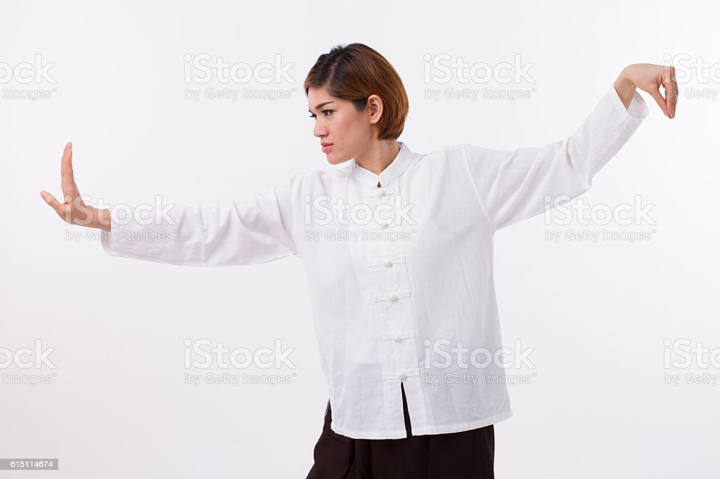 calm, peaceful, strong, confident asian woman practice kungfu stock photo