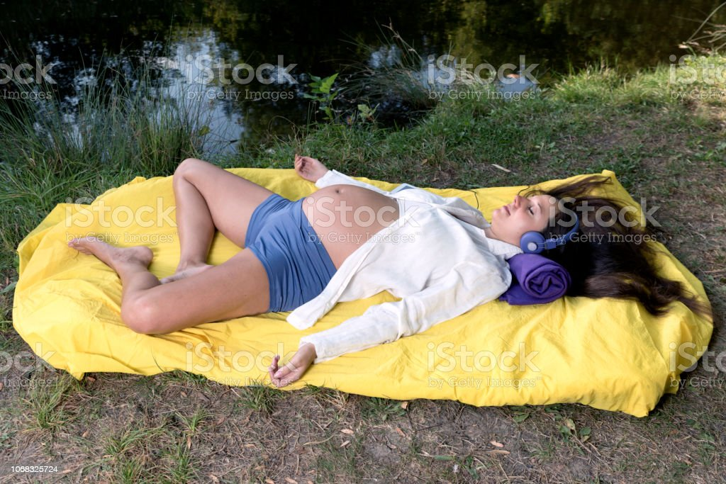 Calm Relax Pregnant Woman Music stock photo